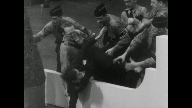 stockvideo's en b-roll-footage met scenes from the nazi rally at madison square garden hosted by the german american bund with a speech from german american leader fritz kuhn; with... - nazism