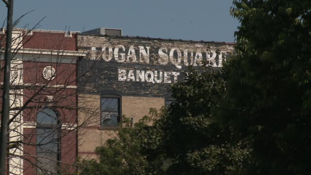 wgn scenes in chicago's logan square neighborhood on september 16 2015 - logan circle stock videos and b-roll footage