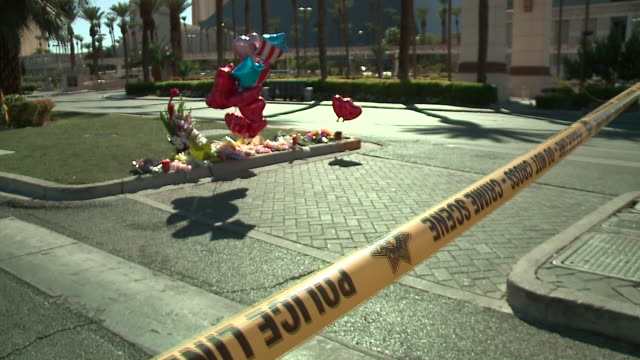 wgn scenes in las vegas four days after stephen paddock fired into a crowd of thousands during route 91 harvest a country music festival from his... - trauerzeit stock-videos und b-roll-filmmaterial