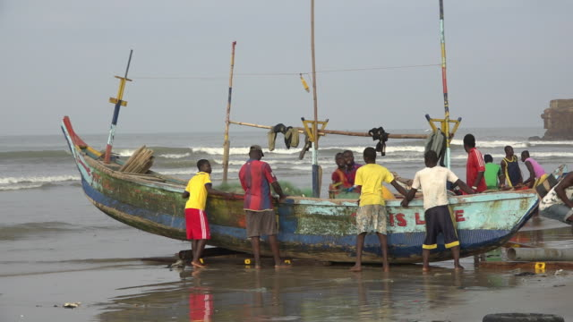 scenes of a fishing community living on the jamestown beach next to accra in ghana - ghana stock videos & royalty-free footage