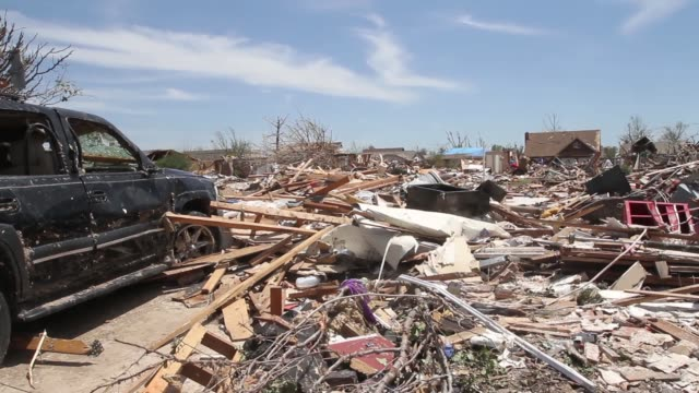 scenes of destruction and people cleaning up after the tornado destruction in moore oklahoma after ef5 tornado on may 22 2013 in moore oklahoma - rubble stock videos & royalty-free footage