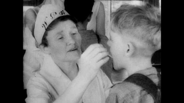 stockvideo's en b-roll-footage met scenes of dust bowl erosion / dust bowl soil blows across the land / wpa workers deliver food to affected farmers / wpa clinics test children for... - 1936