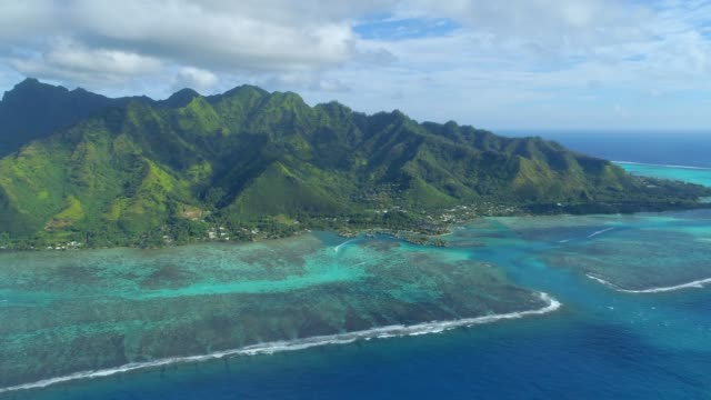 scenic aerial drone view of the lagoon at moorea, french polynesia. - moorea stock videos & royalty-free footage