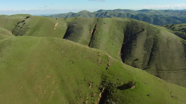 Scenic Aerial Of Green Hills And Mountains
