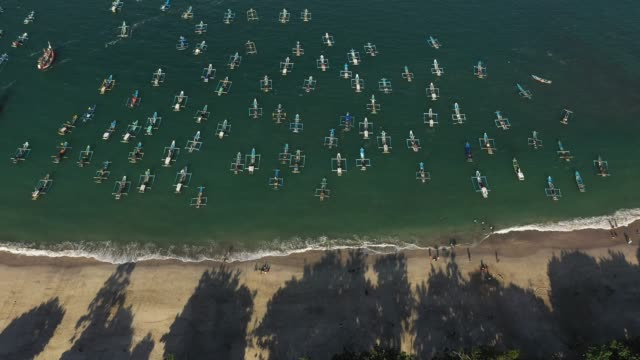 scenic aerial view of a lot of boats on the  seaside on nusa penida - bali stock videos & royalty-free footage