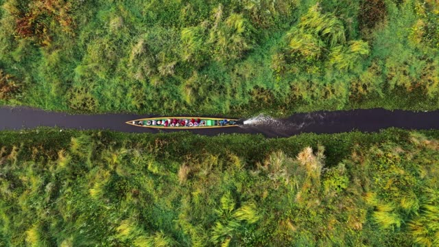 Scenic aerial view of boat on canal  on Inle Lake