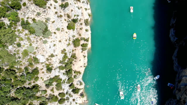 scenic aerial view of boats on  verdon lake - canoeing and kayaking stock videos & royalty-free footage