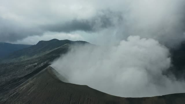 scenic aerial view of bromo volcano erupting - caldera stock videos and b-roll footage