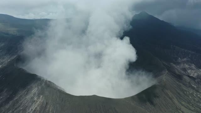 scenic aerial view of bromo volcano erupting - mount semeru stock videos & royalty-free footage