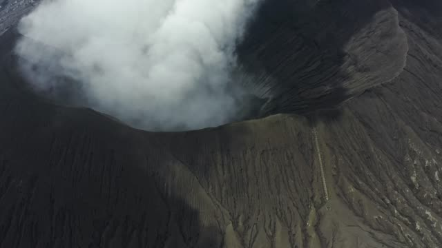 scenic aerial view of bromo volcano erupting - mount bromo stock videos & royalty-free footage