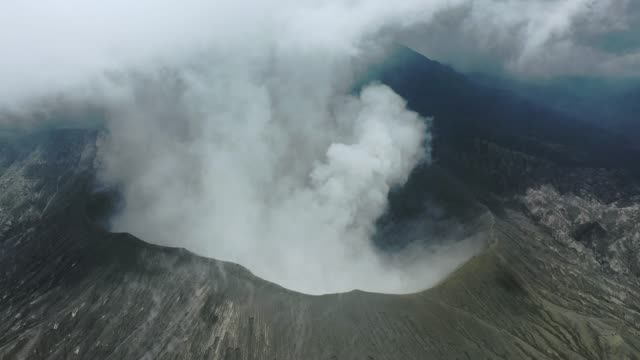 scenic aerial view of bromo volcano erupting - volcano stock videos & royalty-free footage
