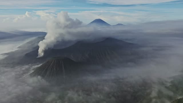 scenic aerial view of bromo volcano erupting - volcanic terrain stock videos & royalty-free footage