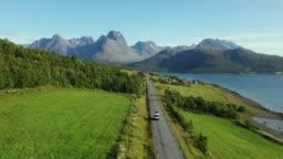 Scenic aerial view of camper van on  road in Norwegian countryside