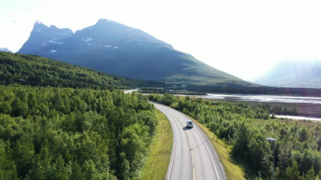scenic aerial view of car on  road in norwegian countryside - drone point of view stock videos & royalty-free footage