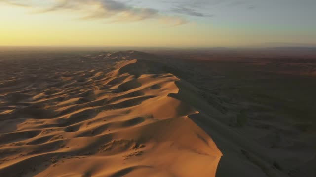 scenic  aerial view of dune in  gobi desert at sunset - independent mongolia stock videos & royalty-free footage