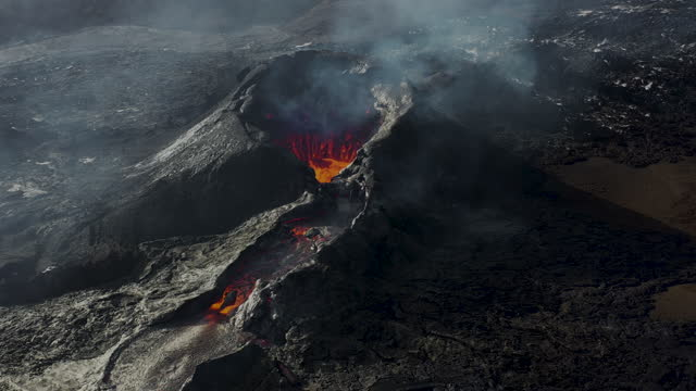 scenic aerial view of fagradalsfjall  volcano eruption in iceland - lava stock videos & royalty-free footage
