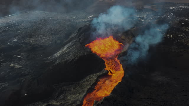 scenic aerial view of fagradalsfjall  volcano eruption in iceland - volcano stock videos & royalty-free footage