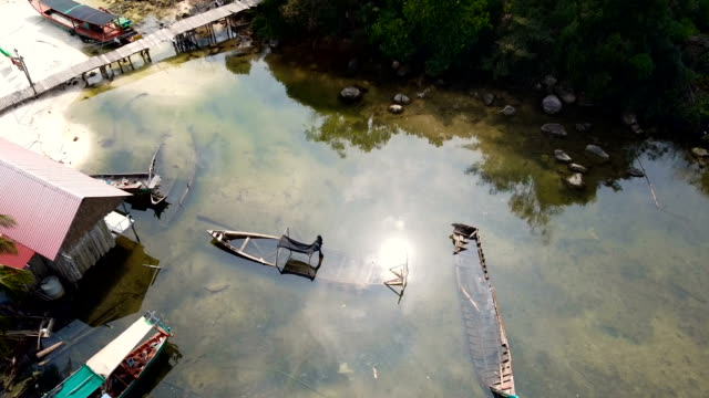 scenic aerial view of fishing village. sunken fishing boats on sea in koh rong island dream beach cambodia - gulf of thailand stock videos & royalty-free footage