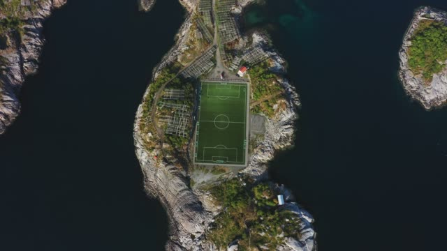 scenic aerial view of football field on lofoten islands - traditionally norwegian stock videos & royalty-free footage