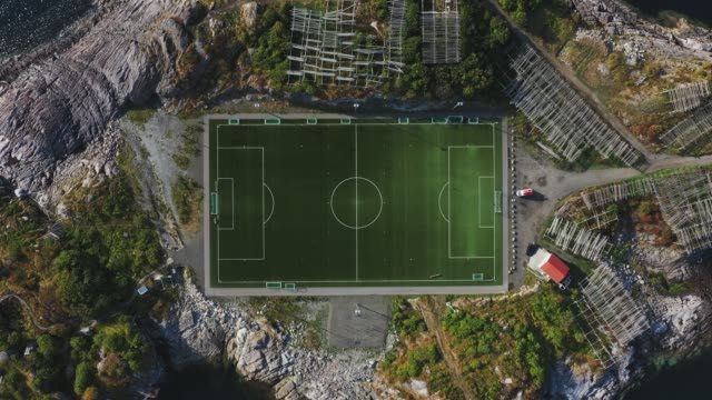 scenic aerial view of football field on lofoten islands - soccer field stock videos & royalty-free footage