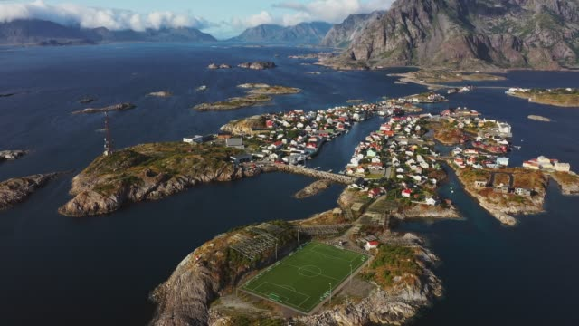 scenic aerial view of football field on lofoten islands - football pitch stock videos & royalty-free footage
