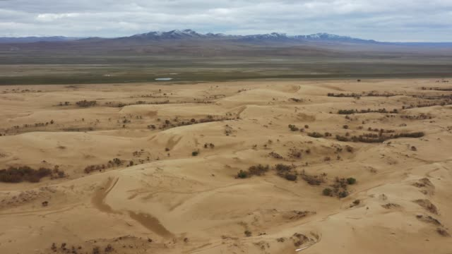 scenic  aerial view of gobi desert at sunset - steppe stock videos & royalty-free footage