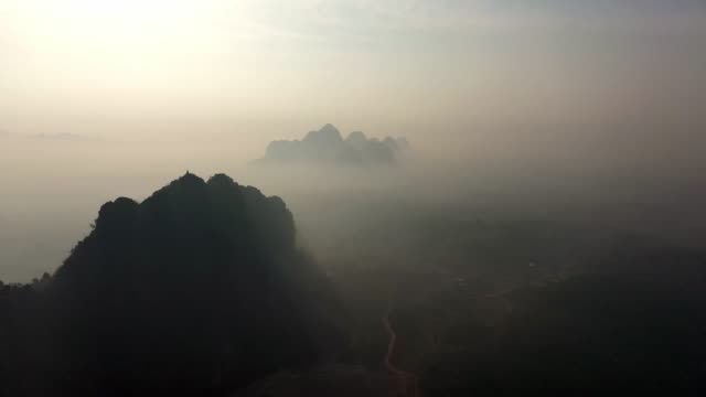 scenic aerial view of golden pagoda in mountains in hpa an in fog - myanmar stock videos and b-roll footage