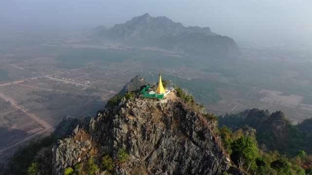 scenic aerial view of golden pagoda in mountains in hpa an - myanmar stock videos and b-roll footage
