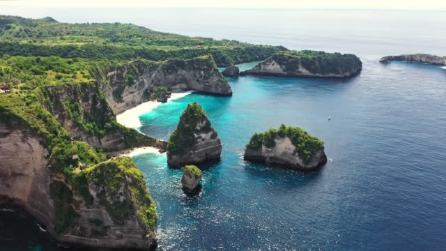 scenic aerial view of kelingking beach on nusa penida - indonesia landmark stock videos & royalty-free footage