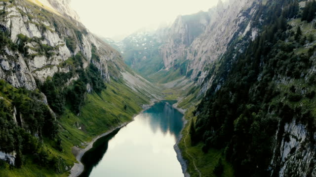 scenic aerial view of lake in  mountains in switzerland - switzerland stock videos & royalty-free footage