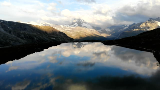 scenic aerial view of lake on the background of  matterhorn mountain - lake stock videos & royalty-free footage