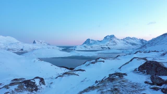 vídeos de stock e filmes b-roll de scenic aerial view of lofoten islands in winter - coberto de neve