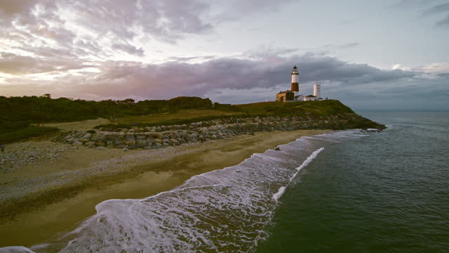 scenic aerial view of montauk lighthouse at sunset. long island, new york state, usa - eastern usa stock videos and b-roll footage