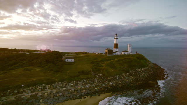 scenic aerial view of montauk lighthouse at sunset. long island, new york state, usa - long island video stock e b–roll