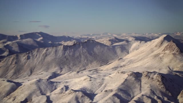 scenic aerial view of mountains in snow - snowcapped mountain stock videos & royalty-free footage