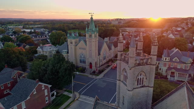 scenic aerial view of nazareth, pennsylvania, with his churches at sunset. aerial drone video with the forward camera motion. - small town america stock videos & royalty-free footage