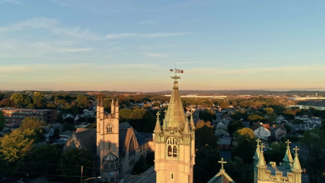 scenic aerial view of nazareth, pennsylvania, with his churches at sunset. aerial drone video with the descending camera motion. - evangelicalism stock videos & royalty-free footage