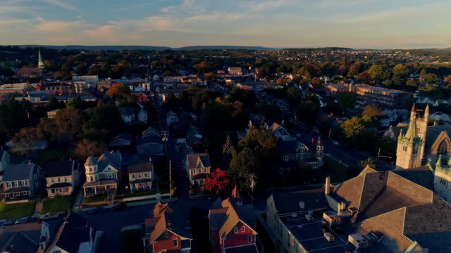scenic aerial view of nazareth, pennsylvania, with his churches at sunset. aerial drone video with the panoramic camera motion. - evangelicalism stock videos & royalty-free footage
