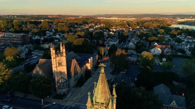 scenic aerial view of nazareth, pennsylvania, with his churches at sunset. aerial drone video with the forward camera motion. - evangelicalism stock videos & royalty-free footage