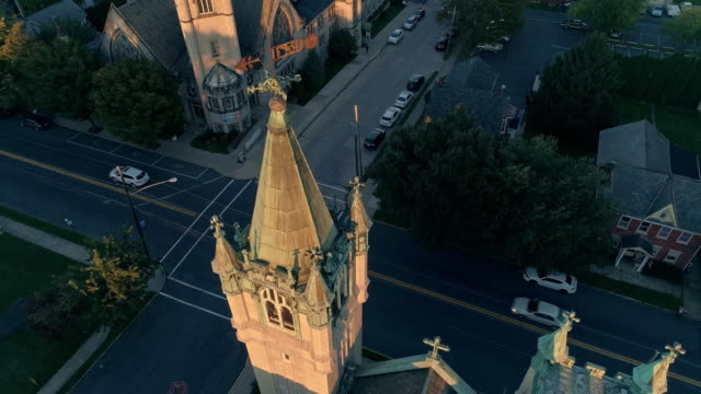 scenic aerial view of nazareth, pennsylvania, with his churches at sunset. aerial drone video with the descending and ешшдештп-up camera motion. neogothic-style st john evangelic lutheran church in the main focus. - evangelicalism stock videos & royalty-free footage