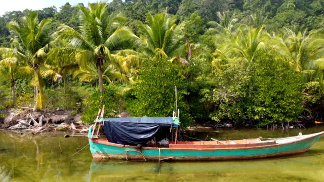 scenic aerial view of palm tree and fishing boat. fishing boat on the river in koh rong island dream beach cambodia - gulf of thailand stock videos & royalty-free footage