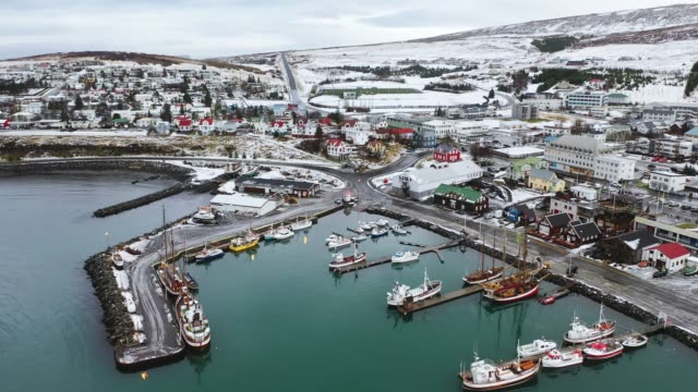 scenic aerial view of port with old ships in husavik, in winter - recreational boat stock videos & royalty-free footage