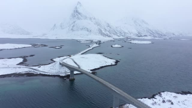 scenic aerial view of  road in lofoten islands in winter - remote location stock videos & royalty-free footage