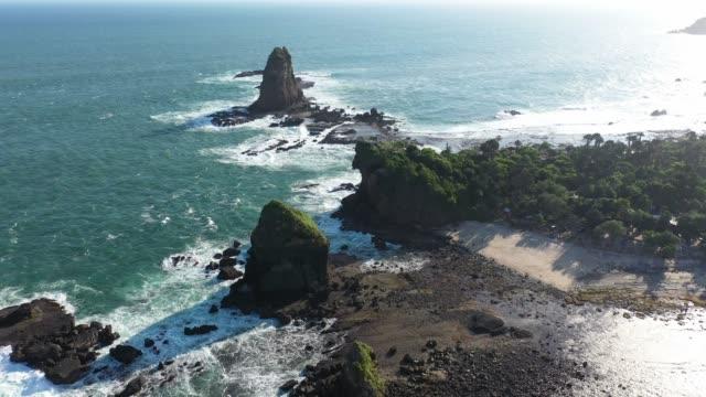 vídeos de stock e filmes b-roll de scenic aerial view of seaside on java, indonesia - coastline
