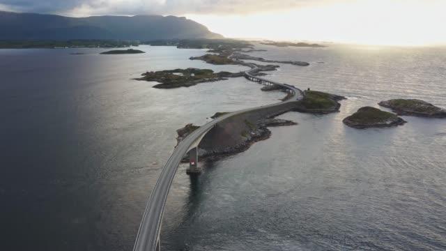 stockvideo's en b-roll-footage met toneelluchtmening van kleine eilanden op eilanden lofoten in de zomer - brug mens gemaakte bouwwerken