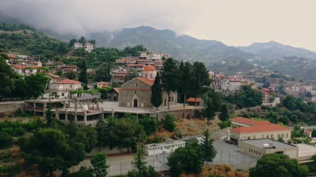 scenic aerial view of town in mountains in cyprus - republic of cyprus stock videos & royalty-free footage
