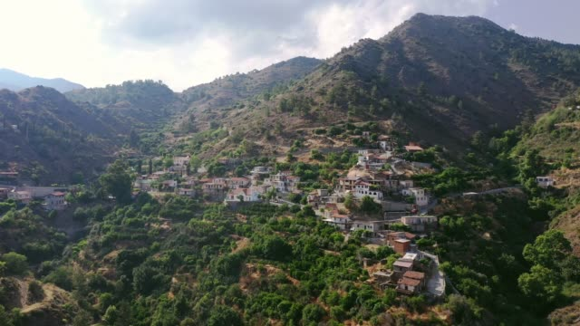 scenic aerial view of town in mountains in cyprus - town stock videos & royalty-free footage