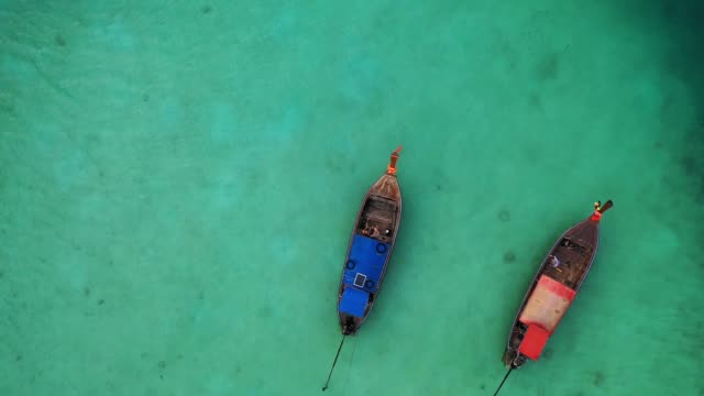 scenic aerial view of two boats on sea in thailand - phi phi islands stock videos & royalty-free footage