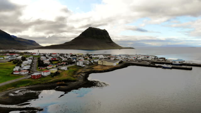scenic aerial view of village near  kirkjufell mountain in iceland - iceland stock videos & royalty-free footage