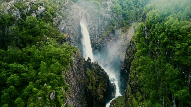 scenic aerial view of voringfossen waterfall and river - waterfall stock videos & royalty-free footage